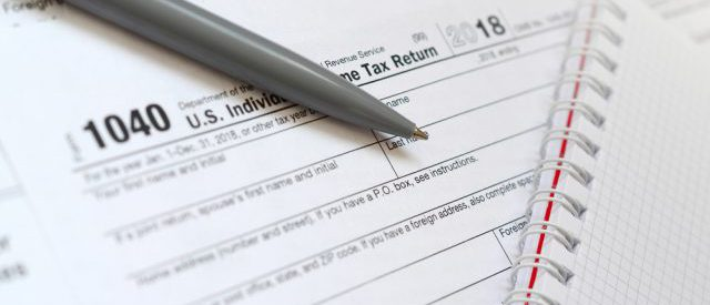 How to Select a Tax Expert, sign, blank return, tax return, 1040, tax form